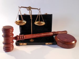 Gavel with sound block and scales of justice